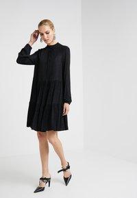 Steffen Schraut - THE  GLAM DRESS - Sukienka z dżerseju - black - 1