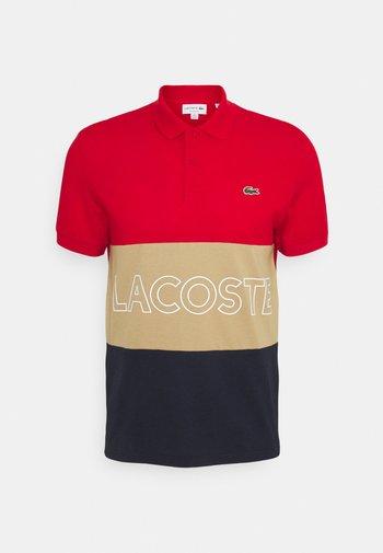 Poloshirt - rouge/viennois marine