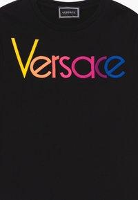 Versace - ABITO - Žerzejové šaty - nero - 3