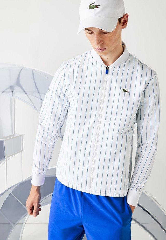 Veste de survêtement - blanc / bleu
