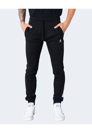 TRI - Pantalones deportivos - black