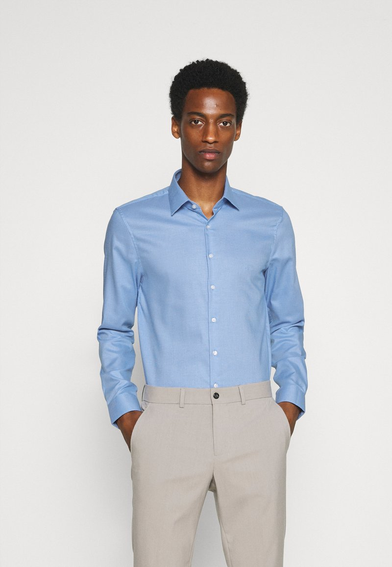 Calvin Klein Tailored - STRUCTURE SLIM  - Formal shirt - light blue