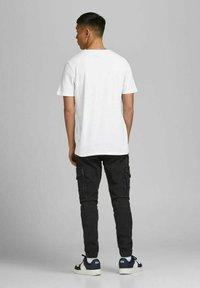 Jack & Jones - JCOALPHA TEE - Print T-shirt - white - 2