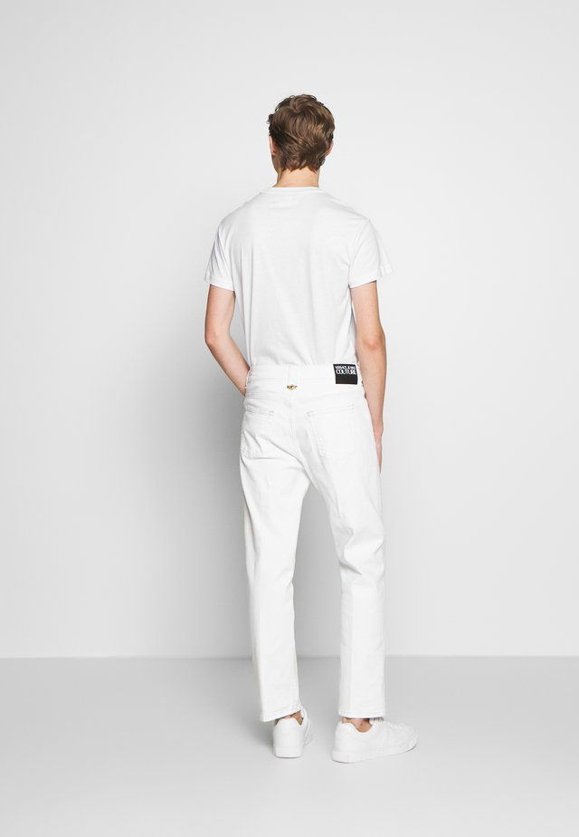 ICON - Straight leg jeans - white