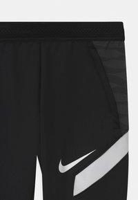 Nike Performance - UNISEX - Tracksuit bottoms - black/anthracite/white - 2