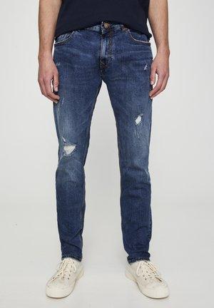 MIT ZIERRISSEN - Slim fit jeans - dark blue