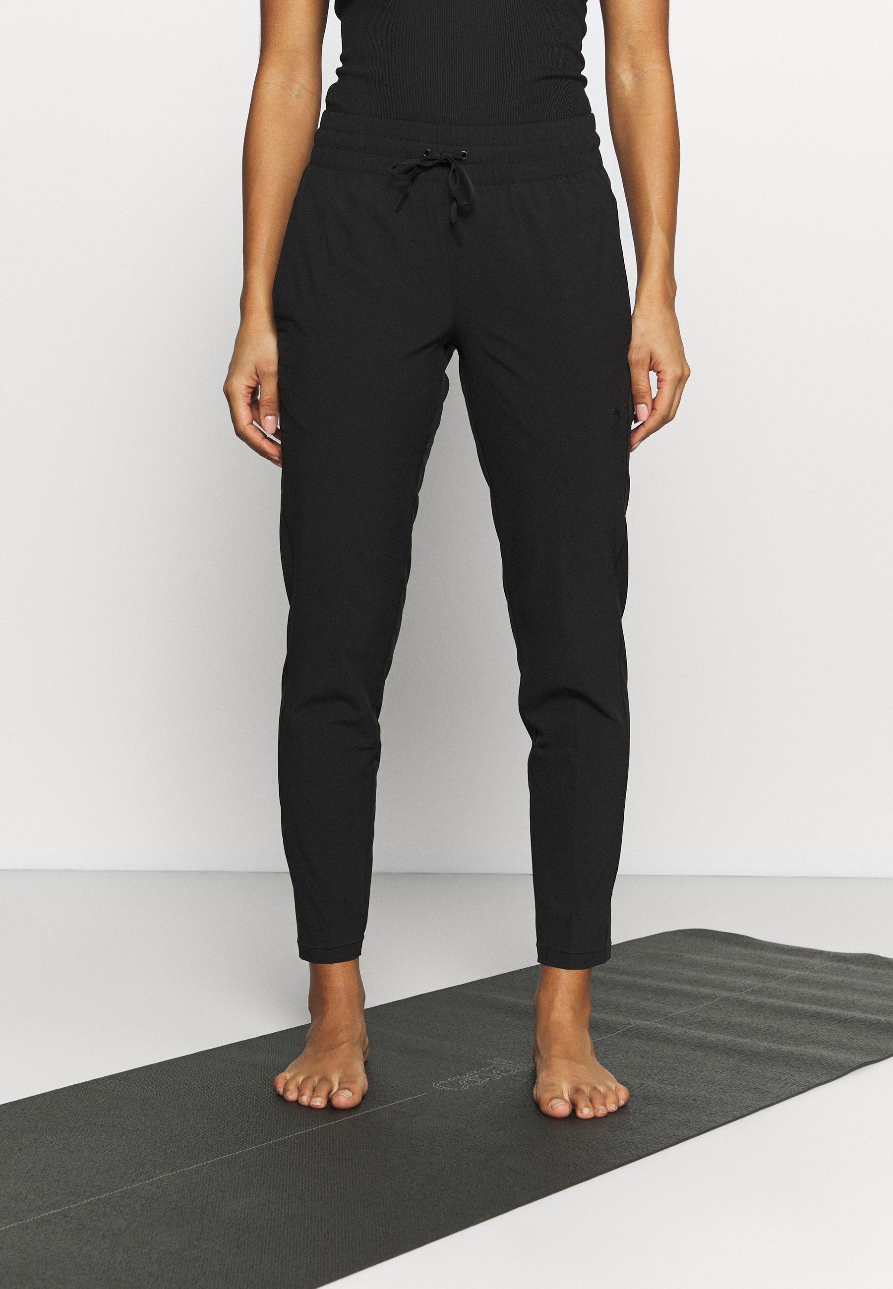 Women STUDIO TAPERED PANT - Tracksuit bottoms