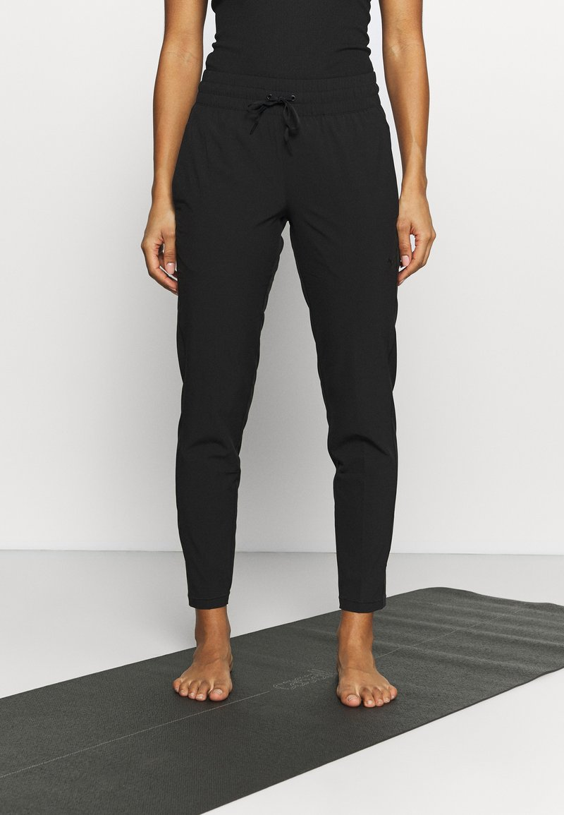 Puma - STUDIO TAPERED PANT - Jogginghose - puma black