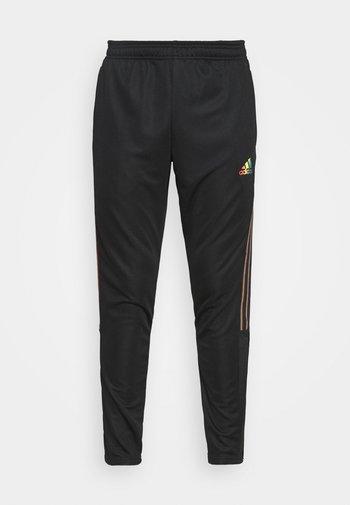 TIRO PRIDE - Teplákové kalhoty - black