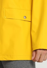 Helly Hansen - MOSS RAIN COAT - Waterproof jacket - essential yellow - 6