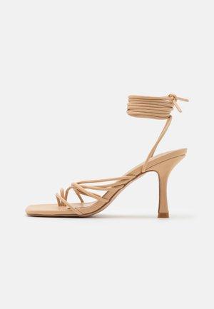 RIYA - Sandals - nude