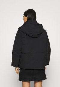 Calvin Klein Jeans - ECO PUFFER JACKET - Vinterjakke - black - 2