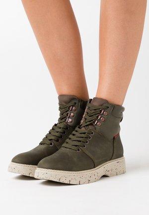 JAXY MID - Platform ankle boots - dark khaki
