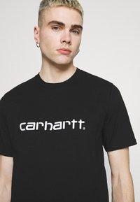 Carhartt WIP - SCRIPT  - Triko spotiskem - black/white - 3