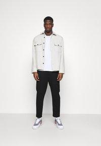 Calvin Klein Jeans - GALFOS MILANO PANT - Pantalon de survêtement - black - 1