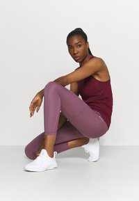 Nike Performance - 7/8 FEMME - Tights - light mulberry/white - 1