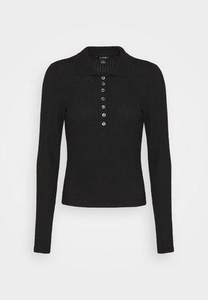 SIBYLLA - Polo shirt - black solid