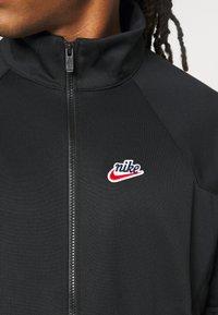 Nike Sportswear - Chaqueta fina - black - 5