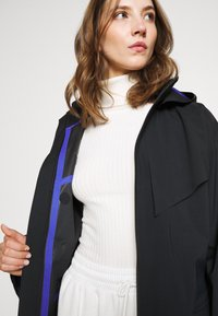 Nike Sportswear - Trenchcoat - black/lapis - 6