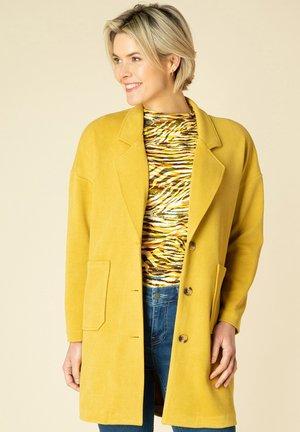 Halflange jas - dark yellow