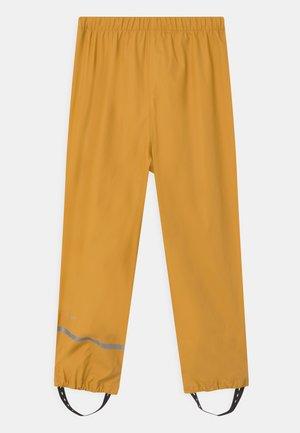 RAINWEAR PANTS SOLID UNISEX - Pantaloni impermeabili - mineral yellow