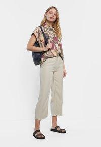 Desigual - RITA - Straight leg jeans - white - 1