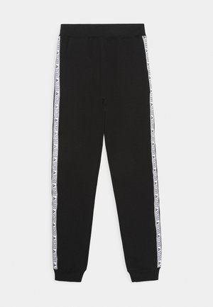 JUNIOR ACTIVE PANTS - Tracksuit bottoms - jet black