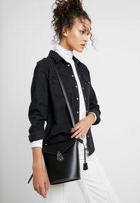 Calvin Klein - LOCK BUCKET - Across body bag - black - 1