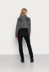 Levi's® - 724 HIGH RISE - Jeans straight leg - black sheep - 2