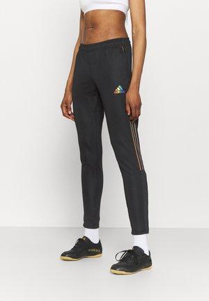TIRO PRIDE - Pantalones deportivos - black