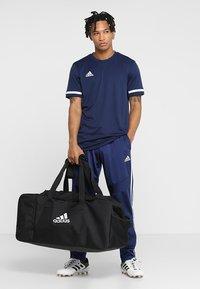 adidas Performance - TIRO DU  - Sports bag - black/white - 1