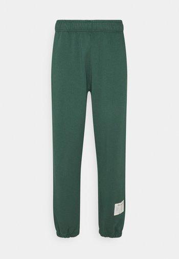 NEUTRALS CUFFED UNISEX green - Pantalon de survêtement - navy