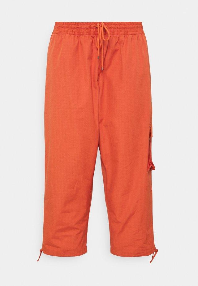 CLASH PANT - Trousers - light sienna/healing orange