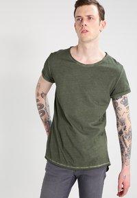 Tigha - MILO - T-shirt - bas - vintage military green - 0