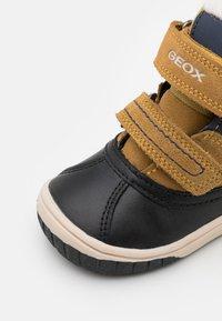 Geox - OMAR BOY WPF - Winter boots - yellow/blue - 5
