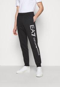 EA7 Emporio Armani - Tracksuit bottoms - black/white - 0