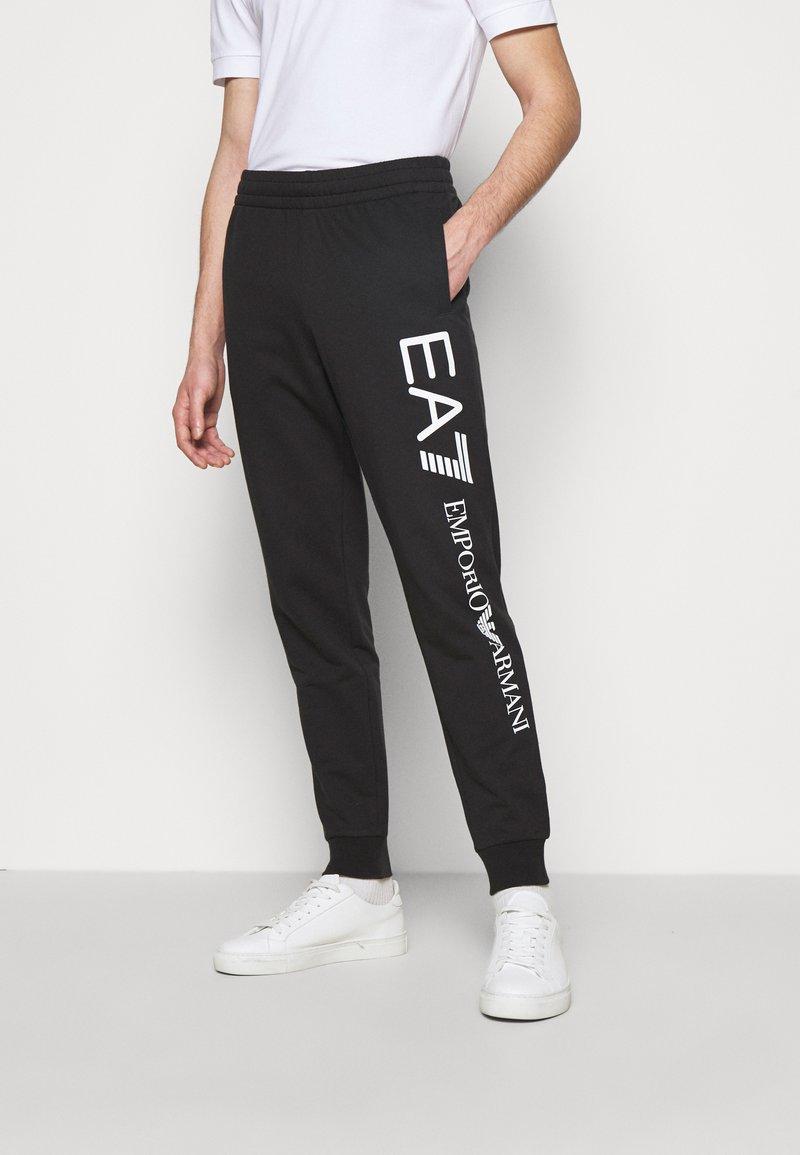 EA7 Emporio Armani - Tracksuit bottoms - black/white