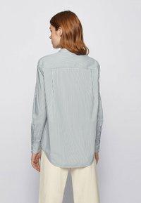 BOSS - BEFELIZE - Button-down blouse - light green - 2