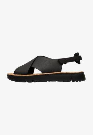 ORUGA - Sandaalit nilkkaremmillä - black