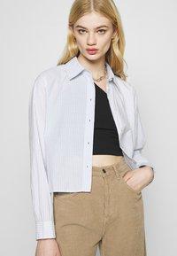 Weekday - GWEN  - Button-down blouse - blue/white - 3