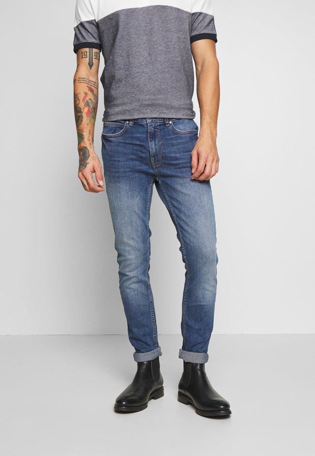 ORGANIC - Slim fit jeans - mid blue