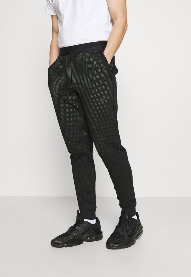 PANT - Pantalon de survêtement - black/mean green