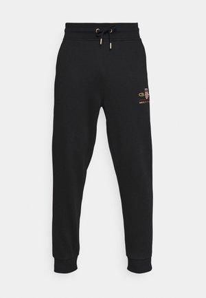 ARCHIVE SHIELD  - Teplákové kalhoty - black