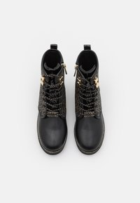 MICHAEL Michael Kors - HASKELL - Lace-up ankle boots - black/gold - 3