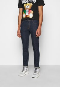 MOSCHINO - TROUSERS - Slim fit jeans - fantasy blue - 0