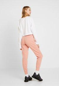 Nike Sportswear - PANT TIGHT - Tracksuit bottoms - pink quartz/white - 2