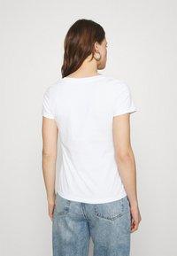 Calvin Klein Jeans - MICRO BRANDING OFF PLACED VNECK - Basic T-shirt - bright white - 2