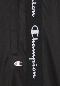 Champion - ELASTIC CUFF PANTS - Tracksuit bottoms - black - 5
