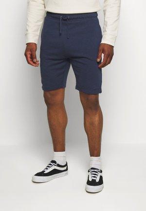 BRODI - Teplákové kalhoty - navy