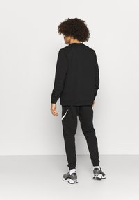 Nike Performance - STORY CREW - Sweatshirt - black - 2